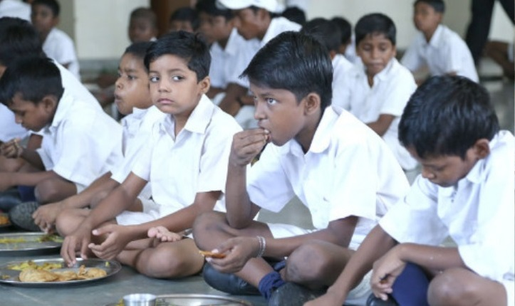 Feed a child from a very poor community in a school hostel