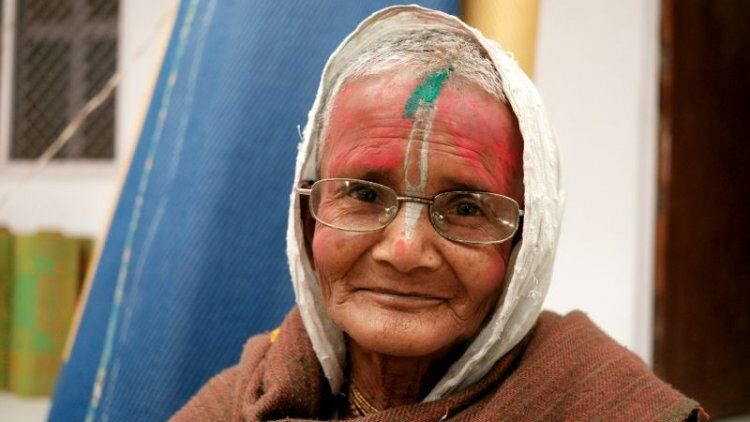 Sponsor the cost of basic clothing for an elderly abandoned widow