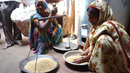 Help poor farmers get access to food grains for their farms and homes